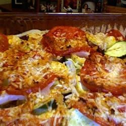 Squash and Zucchini Casserole Recipe - Squash and zucchini are layered along with slices of tomatoes and sweet onion in a buttery, Romano cheese sauce to form a wonderfully tasty casserole.