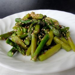 Stir-Fried Sesame Asparagus Recipe - The addition of sesame oil, sesame seeds, and fresh ginger add a lot of fragrance and flavor to a quickly prepared and simple dish loaded with fresh asparagus.