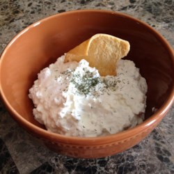 Mediterranean Spread Recipe - Cream cheese, sour cream, feta, and a sprinkle of garlic powder and dill weed make a quick and easy spread for your next gathering.