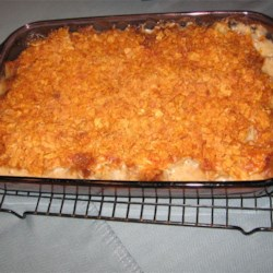 Scrumptious Beef and Potato Casserole Recipe - Cubes of beef and potato are baked together in a mushroom soup and sour cream mixture, and topped with Cheddar cheese and wheat cereal.