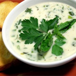 Cream of Herb Soup Recipe - Fresh spinach, basil and parsley are used in this chicken stock based soup which is thickened with heavy cream.  Serve garnished with a sprig of parsley.