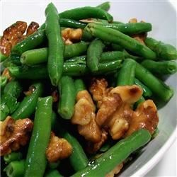 Green Beans With Walnuts Recipe - Super yummy dish that can be prepared in advance, and tossed with hot oil just before the dinner is served. Originally submitted to ThanksgivingRecipe.com.