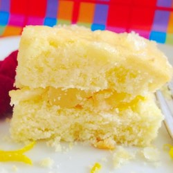 Triple Lemon Cake Recipe - Lemon cake is layered with a sweet lemon filling and topped with a lemon frosting creating a lemon cake with three hits of lemon flavor.