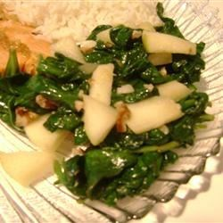 Spinach with Apples and Pine Nuts Recipe - Spinach is lightly cooked with garlic, pine nuts, and apple chunks in olive oil for a delicious side dish.