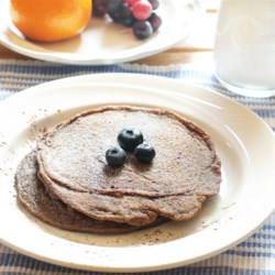 Easy Banana Chia Blueberry Pancakes Recipe - Banana, chia seed, and blueberry pancakes are a hearty way to start the day with an extra boost of flavor from cocoa powder.
