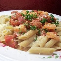 Penne with Shrimp Recipe - Tomatoes and onions are sauteed with garlic and wine, tossed with shrimp, and served with pasta in this quick and easy entree.