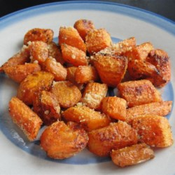 Roasted Parmesan-Garlic Carrots Recipe - Roasting whole carrots gives the vegetable a full-bodied flavor to stand with garlic salt and Parmesan cheese in this easy side dish.