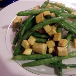 Coconut Curried Tofu with Green Beans and Coconut Rice Recipe - This is the no-fuss curry recipe for 'quick and easy' cooks out there. The rice is simple yet sweet and flavorful and the tofu with green beans will satisfy even the pickiest eaters.