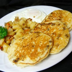 Savory Sausage Pancakes Recipe - Breakfast for breakfast or breakfast for dinner. Either way, these savory pancakes are filled with crumbled sausage and taste great with a drizzle of maple syrup.