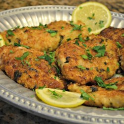 Mediterranean Crusted Chicken Recipe - A deliciously rich chicken entree that is best served with mild side dishes such as sauteed vegetables and French bread. This chicken has a great fresh basil flavor.
