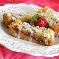 Strawberry Jam Marzipan Bars Recipe - A layer of strawberry jam is sandwiched between a buttery, almond topping and brown sugar crust creating a sweet and delicate cookie bar.