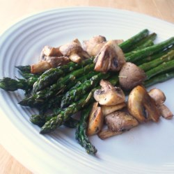 Roasted Asparagus and Mushrooms Recipe - A delicious and easy side dish can be made by tossing asparagus and mushrooms together with olive oil and rosemary. I love roasting veggies and hit on this WONDERFUL combo. You could use a Hollandaise on the side.... but why??