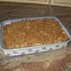 Noodle Pudding Recipe - Rich and sweet sour cream and cottage cheese mixture with noodles topped with a crumbly graham cracker topping.