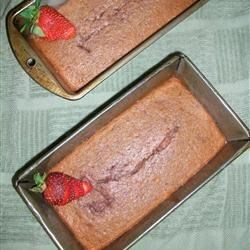 Christmas Strawberry Bread Recipe - This beautifully pink, moist bread is a favorite at our house. Neighbors and friends look forward to receiving it for Christmas every year. Most people ask for the recipe.