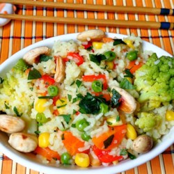 Indian-Style Vegetable Rice Recipe - This is a standard Indian pilaf dish with a slight twist. The combination of colorful vegetables and aromatic spices make this dish very tasty!