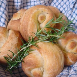Potato Rosemary Rolls Recipe - Fresh rosemary permeates these chewy and tender yeast rolls, made with a little help from your bread machine.