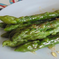 Easiest Asparagus Recipe Recipe - Just saute asparagus in a bit of butter and flavor with honey, cayenne pepper, and garlic powder for a fast and flavorful vegetable dish.