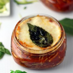 Baked Zucchini Cups Recipe - Shredded zucchini and Ragu(R) Old World Style(R) Traditional Sauce are topped with shredded mozzarella cheese and baked in individual serving dishes for an easy weeknight side dish.
