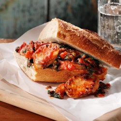 Tuscan-Style Sausage Sandwiches Recipe - A rich pasta sauce with Italian sausage, sliced onions, spinach, and mushrooms is spooned onto split chunks of crusty bread for a hearty lunch or dinner.