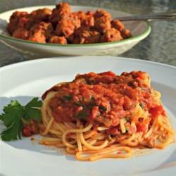 Italian Meat Sauce II Recipe - My standard sauce with meatballs, pork, and sausage. Delicious alone, on a sandwich, or over any pasta. Abruzzi recipe.