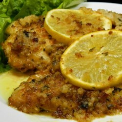 Chicken Francesa Recipe - Breaded and baked chicken is topped with a white wine reduction creating a fancy main dish for dinner parties or romantic dinners.
