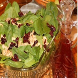 Sparkling Cranberry Dressing Recipe - Made with club soda, cranberry sauce, sugar, and cinnamon, this quick and easy sparkling dressing is perfect for a spinach salad.