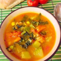 Simple Veggie Soup Recipe - Use tomato-vegetable juice cocktail with broth to make the base for this soup packed with vegetables, including cabbage, squash, carrots, and spinach.