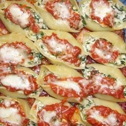 Spinach and Cheese Stuffed Pasta Shells Recipe - Magnificent jumbo pasta shells stuffed to bursting with cheesy spinach filling.