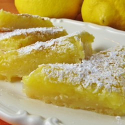 Luscious Lemon Triangles Recipe - These lemony treats use lemon zest and fresh lemon juice to deliver a high-quality version of a classic dessert.