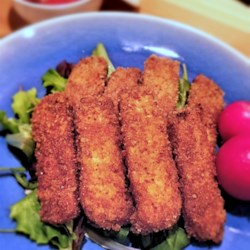 Vegan Breaded Tofu Recipe - Tofu is breaded in a vegan-based spread and baked into a crispy, vegan appetizer or main dish.