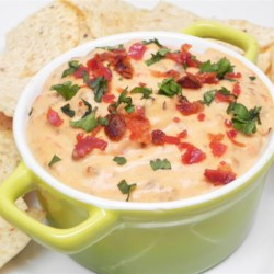 Spicy Bacon Cheeseburger Dip Recipe - The flavors of a bacon cheeseburger combine in this recipe to make a hearty and easy-to-put-together dip that feeds a big crowd!