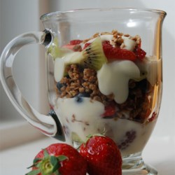 Summer Berry Parfait with Yogurt and Granola Recipe - This colorful and wholesome breakfast parfait is nice enough for company, and easy enough for everyday. This parfait is particularly attractive when served in a clear glass to show off the lovely layers.