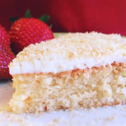 Gluten-Free Coconut Cake Recipe - Gluten-free coconut cake with walnuts gets a double dose of coconut from flaked coconut and coconut milk added to the batter. Frost with a simple vanilla buttercream.