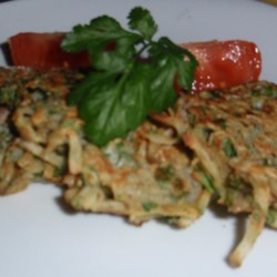 Potato Pancakes with an Eastern Twist - Gluten-Free Recipe - Potato pancakes with tomatoes, chickpea flour, and a little garam masala are a delicious and gluten-free twist on traditional potato pancakes.
