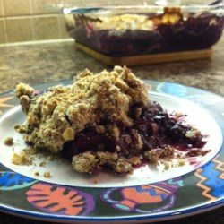 Blueberry Crunch Recipe - Blueberries and pineapple are baked under a buttery oat topping, called a blueberry crunch, that the whole family will love.
