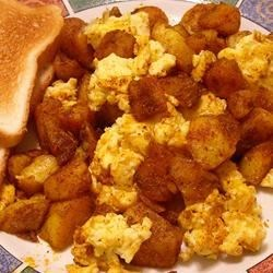 Spicy Potatoes and Scrambled Eggs Recipe - Spicy fried potatoes and a classic egg scramble combine to make a hearty and zesty breakfast.