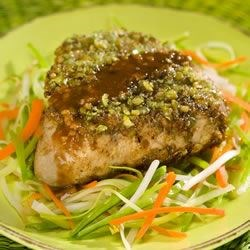 Wasabi Encrusted Tuna Steaks Recipe - Marinated tuna steaks are coated with crushed, spicy wasabi peas, then served with a marinade reduction.