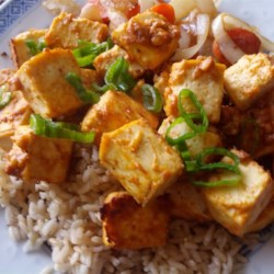 Spicy Baked Tofu Recipe - Marinate tofu in a mix of rice vinegar, peanut butter, ketchup, garlic, and soy sauce, and discover that tofu really can be tasty!