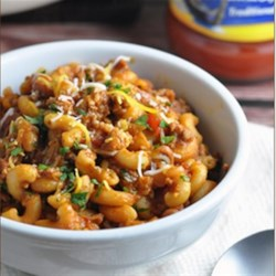 One-Pot Chili Mac and Cheese Recipe - This delicious chili mac and cheese with ground beef, diced tomatoes, rich tomato sauce, chili beans and spices is cooked all in one pot--including the macaroni!