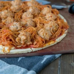 Spaghetti and Meatball Pizza Recipe - Turn pizza night into something new by topping it with spaghetti and meatballs!