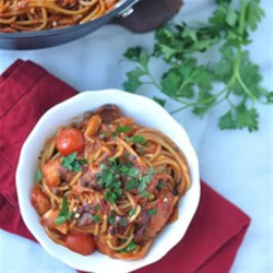 Easy One-Pot Pasta Puttanesca Recipe - Pasta and sauce simmer together, along with kalamata olives, capers, garlic, and tomatoes for a quick weeknight dinner with easy clean up.