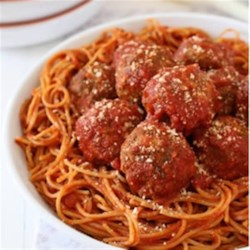 Mama's Best Ever Spaghetti and Mozzarella Meatballs Recipe - Baked homemade meatballs are served over hot spaghetti with lots of sauce and grated Parmesan cheese.