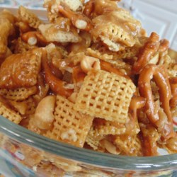 Game Day Crunch Recipe - Cereal squares, pretzels, and peanuts are tossed in a salty caramel sauce for the perfect crunchy snack for Game Days.