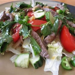 Thai Grilled Beef Salad Recipe - Grilled flank steak is tossed with a delicious Thai dressing making a refreshing summer dish!