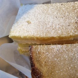 Best Lemon Squares Recipe - Lemony custard is baked on top of a simple crust in this recipe for the best lemon squares that has been passed down through many generations.