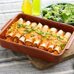 Easy Creamy Chicken Enchiladas Recipe - This enchilada dish is sure to be a new family favorite; it is simple to put together and also perfect for leftovers . . . if you ever have any!