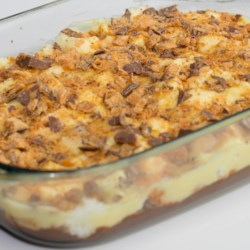 Angel Pudding Recipe - Angel food pieces, chocolate and vanilla pudding, layered with crushed peanut-buttery candy and chilled.