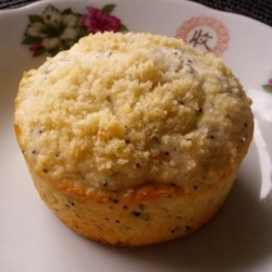 Almond-Poppy Seed Muffins Recipe - Sour cream helps make rich almond-poppy seed muffins in this recipe. You can even leave the almonds out, if you prefer, thanks to the almond extract.