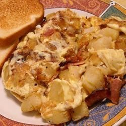 Bauernomlett (Farmer's Omelet) Recipe - Eggs, bacon and potatoes all blend into one dish for a simple breakfast option. Serve it with ketchup for the kids or with a dill pickle for a German-style brunch.
