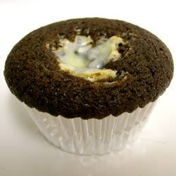 Chocolate Surprise Cupcakes Recipe - Rich chocolate cupcakes with cream cheese and chocolate chip center. Also known as Black Bottom Cupcakes.